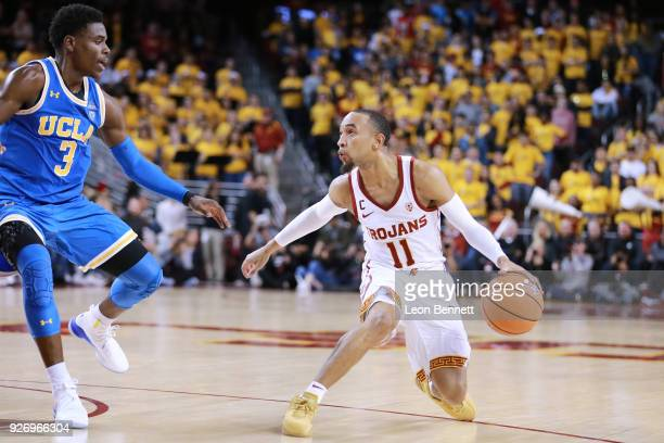 Jordan McLaughlin of the USC Trojans handles the ball against Aaron Holiday of the UCLA Bruins during a PAC12 college basketball game at Galen Center...