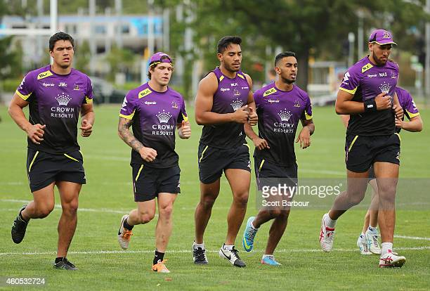 Jordan McLean Nelson Asofa Solomona and Storm teammates run during a Melbourne Storm NRL training session at Gosch's Paddock on December 16 2014 in...