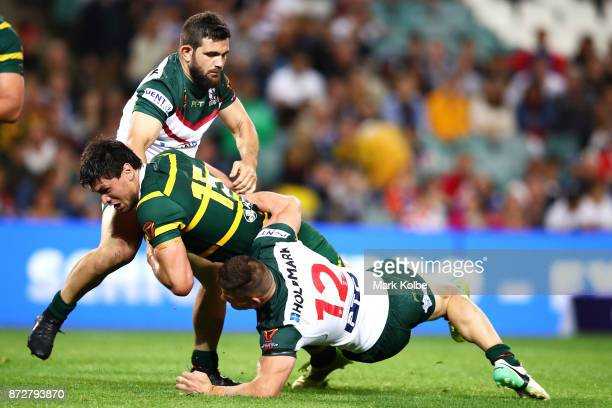 Jordan Mclean of Australia is tackled during the 2017 Rugby League World Cup match between Australia and Lebanon at Allianz Stadium on November 11...