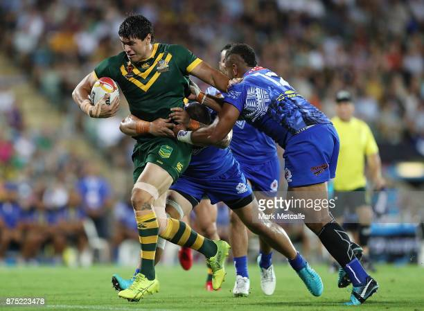 Jordan Mclean of Australia is tackled during the 2017 Rugby League World Cup Quarter Final match between Australia and Samoa at Darwin Stadium on...