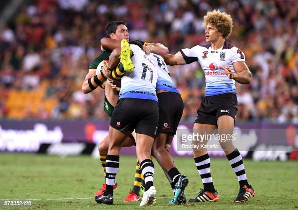 Jordan McLean of Australia is tackled during the 2017 Rugby League World Cup Semi Final match between the Australian Kangaroos and Fiji at Suncorp...