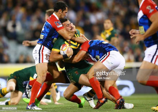Jordan McLean of Australia is tackled high during the 2017 Rugby League World Cup match between Australian Kangaroos and France at Canberra Stadium...