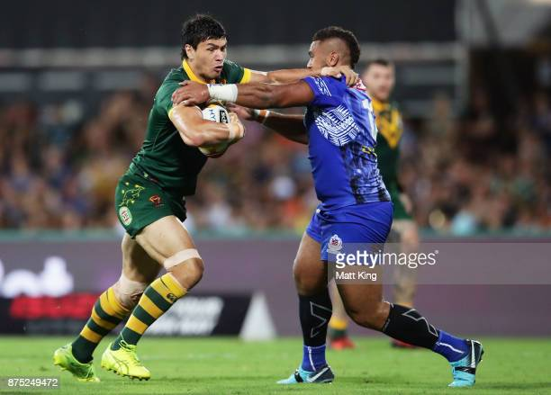 Jordan Mclean of Australia puts a fend on Frank Pritchard of Samoa during the 2017 Rugby League World Cup Quarter Final match between Australia and...