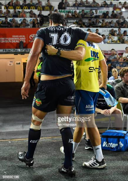 Jordan McLean of the Cowboys comes from the field after being injured during the round four NRL match between the North Queensland Cowboys and the...