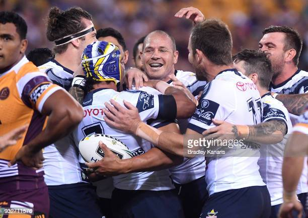 Jordan McLean of the Cowboys is congratulated by team mates after scoring a try during the round two NRL match between the Brisbane Broncos and the...