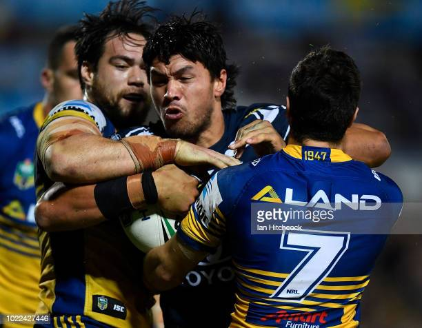 Jordan McLean of the Cowboys is tackled by Mitchell Moses of the Eels during the round 24 NRL match between the North Queensland Cowboys and the...