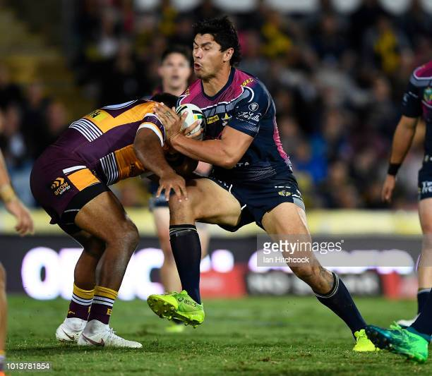 Jordan McLean of the Cowboys is tackled by Sam Thaiday of the Broncos during the round 22 NRL match between the North Queensland Cowboys and the...