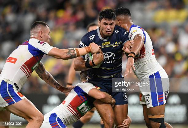 Jordan McLean of the Cowboys is tackled during the round 11 NRL match between the North Queensland Cowboys and the Newcastle Knights at QCB Stadium,...