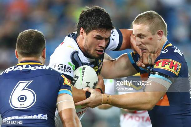 Jordan McLean of the Cowboys is tackled during the round 12 NRL match between the Gold Coast Titans and the North Queensland Cowboys at Cbus Super...