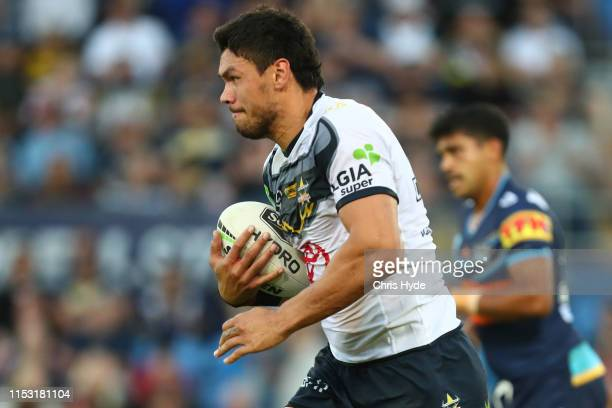Jordan McLean of the Cowboys runs the ball during the round 12 NRL match between the Gold Coast Titans and the North Queensland Cowboys at Cbus Super...