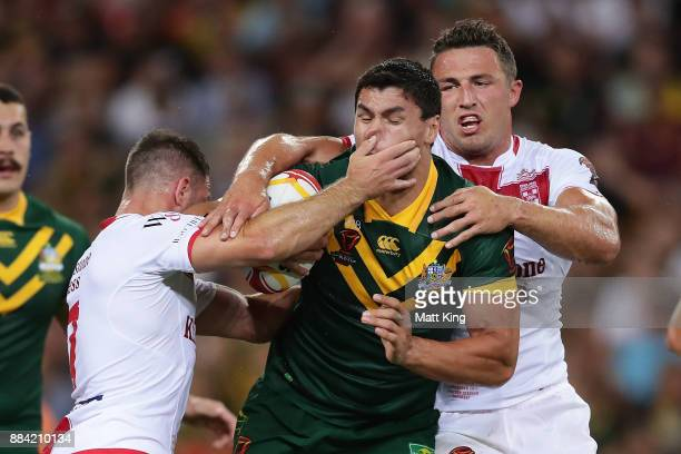 Jordan McLean of the Kangaroos is tackled during the 2017 Rugby League World Cup Final between the Australian Kangaroos and England at Suncorp...