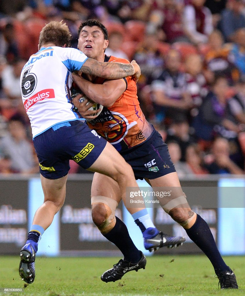 Jordan McLean of the Storm attempts to break through the defence during the round 10 NRL match between the Melbourne Storm and the Gold Coast Titans at Suncorp Stadium on May 13, 2017 in Brisbane, Australia.