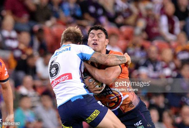 Jordan McLean of the Storm attempts to break through the defence during the round 10 NRL match between the Melbourne Storm and the Gold Coast Titans...