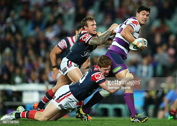 Jordan McLean of the Storm breaks the Roosters defence during the NRL qualifying final match between the Sydney Roosters and the Melbourne Storm at...