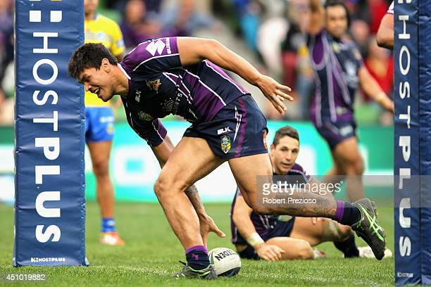 Jordan McLean of the Storm crosses the line to score a try during the round 15 NRL match between the Melbourne Storm and the Parramatta Eels at AAMI...