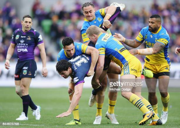 Jordan McLean of the Storm gets tackled during the NRL Qualifying Final match between the Melbourne Storm and the Parramatta Eels at AAMI Park on...