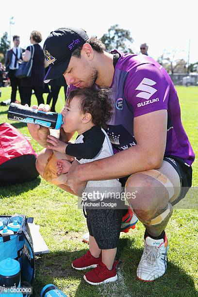 Jordan McLean of the Storm gives his son Archie a drink during a Melbourne Storm NRL training session at Gosch's Paddock on September 28 2016 in...