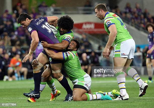 Jordan McLean of the Storm is challenged by his opponents during the NRL Preliminary Final match between the Melbourne Storm and the Canberra Raiders...