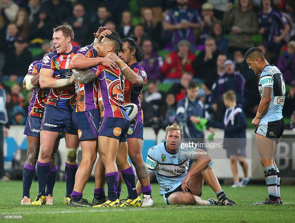 Jordan McLean of the Storm is congratulated by Tim Glasby and his teammates after scoring a try during the round 23 NRL match between the Melbourne Storm and the Cronulla Sharks at AAMI Park on August 16, 2014 in Melbourne, Australia.