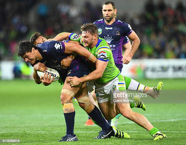 Jordan McLean of the Storm is tackled during the NRL Preliminary Final match between the Melbourne Storm and the Canberra Raiders at AAMI Park on...