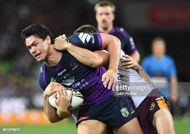 Jordan McLean of the Storm is tackled during the NRL Preliminary Final match between the Melbourne Storm and the Brisbane Broncos at AAMI Park on...