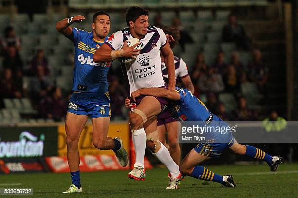 Jordan McLean of the Storm is tackled during the round 11 NRL match between the Parramatta Eels and the Melbourne Storm at Pirtek Stadium on May 23...