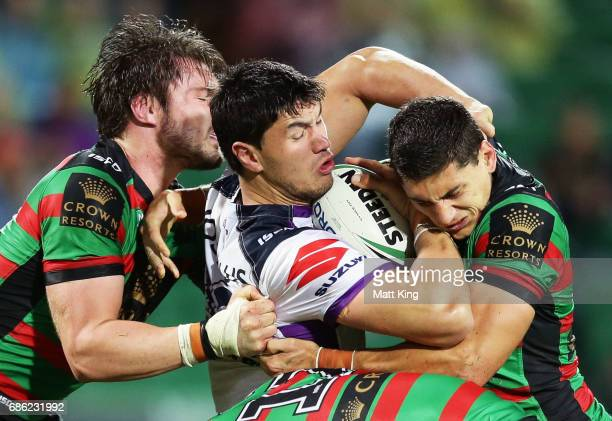 Jordan McLean of the Storm is tackled during the round 11 NRL match between the South Sydney Rabbitohs and the Melbourne Storm at nib Stadium on May...
