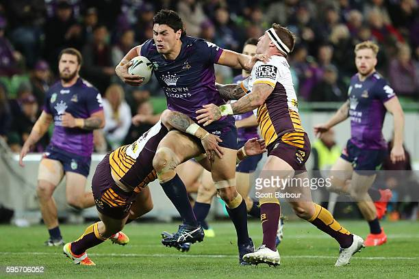 Jordan McLean of the Storm is tackled during the round 25 NRL match between the Melbourne Storm and the Brisbane Broncos at AAMI Park on August 26,...
