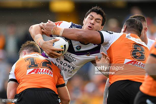 Jordan McLean of the Storm is tackled during the round seven NRL match between the Wests Tigers and the Melbourne Storm at Leichhardt Oval on April...