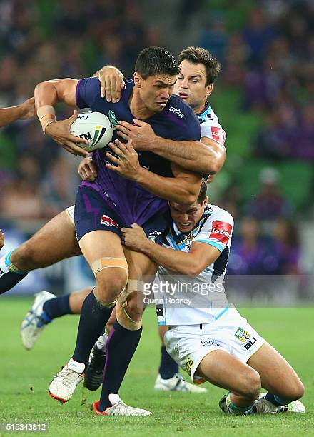 Jordan McLean of the Storm is tackled during the round two NRL match between the Melbourne Storm and the Gold Coast Titans at AAMI Park on March 13,...