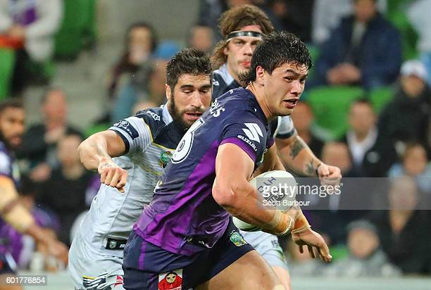 Jordan McLean of the Storm runs with the ball during the NRL Qualifying Final match between the Melbourne Storm and the North Queensland Cowboys at...