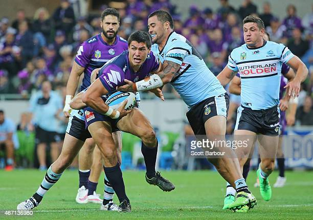 Jordan McLean of the Storm runs with the ball during the round three NRL match between the Melbourne Storm and the Cronulla Sharks at AAMI Park on...
