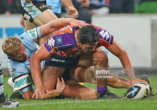 Jordan McLean of the Storm scores a try during the round 23 NRL match between the Melbourne Storm and the Cronulla Sharks at AAMI Park on August 16...