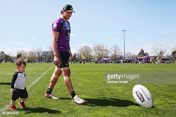 Jordan McLean of the Storm walks off with his son Archie during a Melbourne Storm NRL training session at Gosch's Paddock on September 28 2016 in...