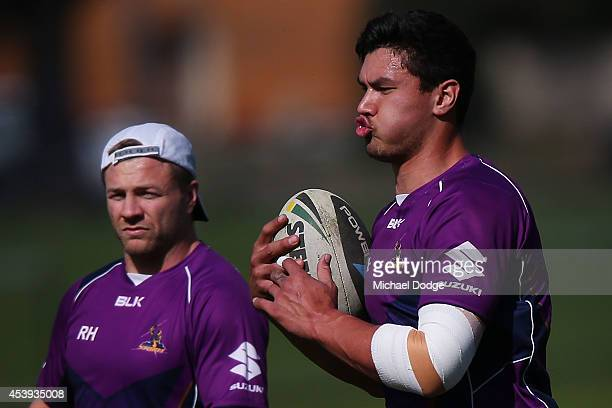 Jordan McLean runs with the ball during a Melbourne Storm NRL training session at Gosch's Paddock on August 22 2014 in Melbourne Australia