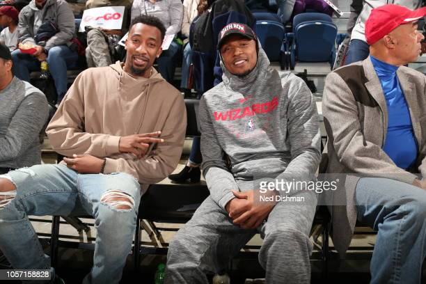 Jordan McRae and Bradley Beal of the Washington Wizards sit and watch during an NBA G-League game between the Capital City Go-Go and Greensboro Swarm...