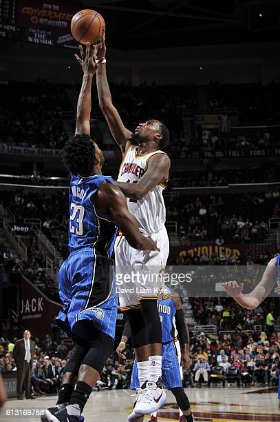 Jordan McRae of the Cleveland Cavaliers shoots the ball against CJ Wilcox of the Orlando Magic on October 5 2016 at Quicken Loans Arena in Cleveland...