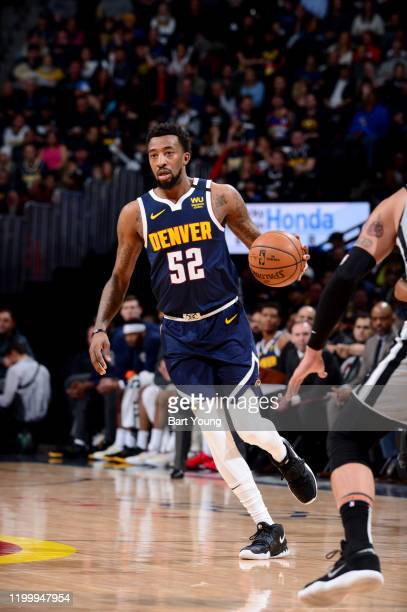 Jordan McRae of the Denver Nuggets handles the ball during a game against the San Antonio Spurs on February 10 2020 at the Pepsi Center in Denver...