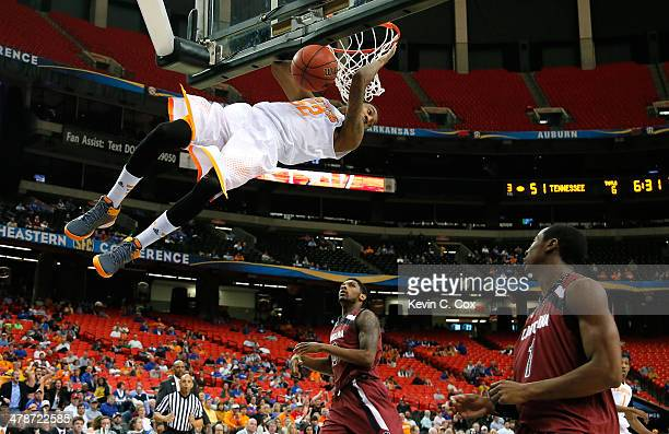 Jordan McRae of the Tennessee Volunteers dunks against Sindarius Thornwell and Brenton Williams of the South Carolina Gamecocks against during the...