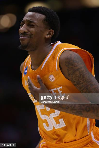 Jordan McRae of the Tennessee Volunteers reacts after missing the final shot of the game to be defeated by the Michigan Wolverines 73 to 71 during...