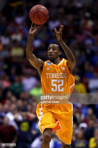 Jordan McRae of the Tennessee Volunteers shoots the ball to miss the final shot to be defeated by the Michigan Wolverines 73 to 71 during the...