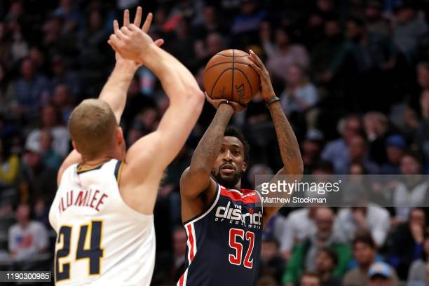 Jordan McRae of the Washington Wizards puts up a shot over Mason Plumlee of the Denver Nuggets in the second quarter at the Pepsi Center on November...