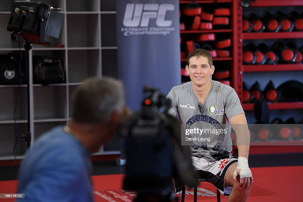 Jordan Mein answers questions for a TV interview after a public training session on April 9, 2013 at Champion's Creed Gym in Calgary, Alberta, Canada.
