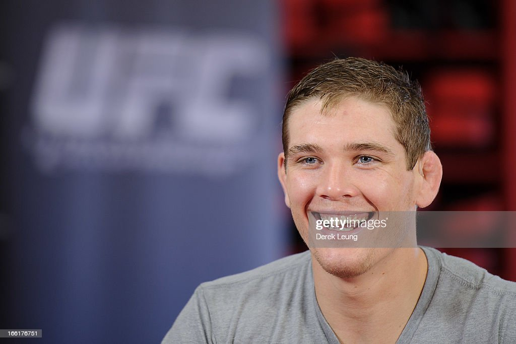 Jordan Mein smiles as he answers questions for a TV interview after a public training session on April 9, 2013 at Champion's Creed Gym in Calgary, Alberta, Canada.