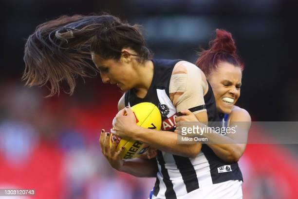 Jordan Membrey of the Magpies is tackled by Jenna Bruton of the Kangaroos during the round four AFLW match between the North Melbourne Kangaroos and...