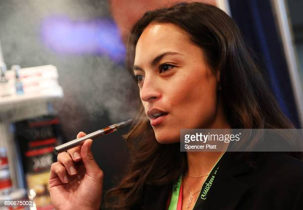 Jordan Michelle vapes a CBD oil made from hemp at the Cannabis World Congress Conference on June 16 2017 in New York City Billed as the leading trade...