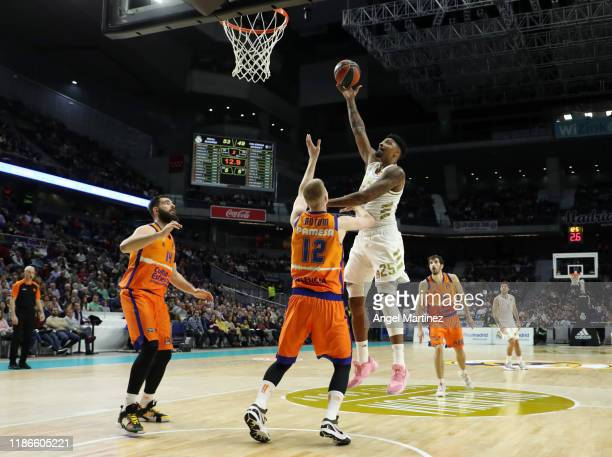 Jordan Mickey, #25 of Real Madrid competes with Brock Motum, #12 of Valencia Basket during the 2019/2020 Turkish Airlines EuroLeague Regular Season...