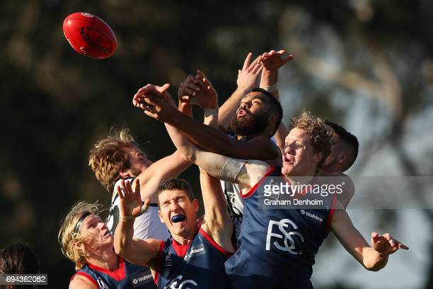 Jordan Moncrieff and Declan Keilty of the Casey Demons compete in the air during the round eight VFL match between Casey Demons and Collingwood...