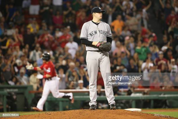 Jordan Montgomery of the New York Yankees looks on as Christian Vazquez of the Boston Red Sox rounds the bases after hitting a solo home run in the...