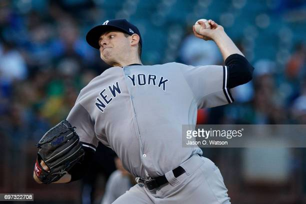 Jordan Montgomery of the New York Yankees pitches against the Oakland Athletics during the first inning at the Oakland Coliseum on June 15 2017 in...